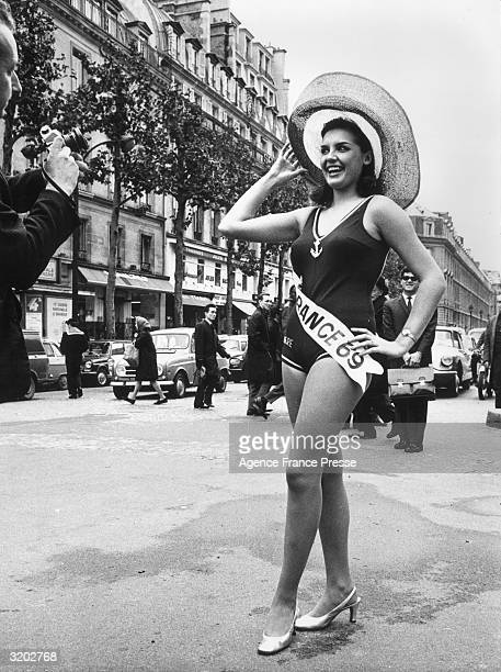 Fulllength image of Suzanne Angly Miss France 1969 posing in a bathing suit on a city street shortly before departing for London England where she...
