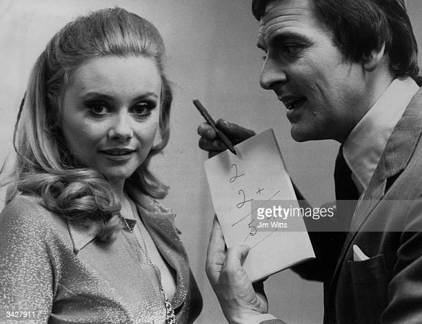 British television entertainer Bob Monkhouse and Anne Aston his copresenter on the Golden Shot