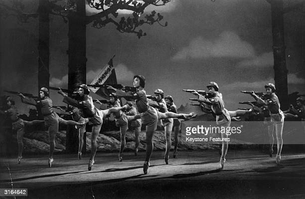 Dancers from 'The Modern Ballet of the Revolution' aim their rifles during a scene from a revolutionary ballet performance in Peking