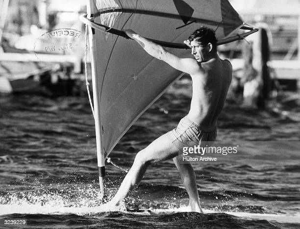 Charles, Prince of Wales windsurfing.