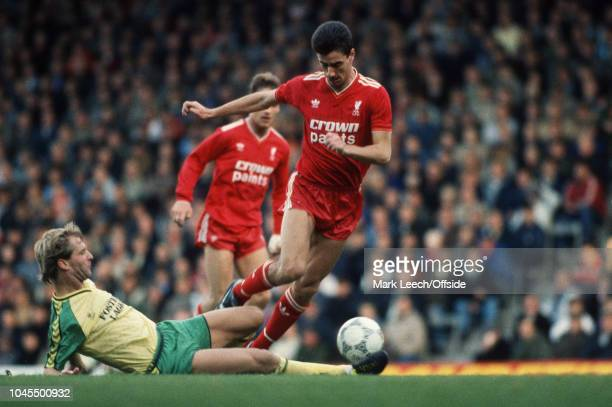 November 1986 - Football League Division 1 - Liverpool v Norwich City - Ian Rush of Liverpool evades a tackle by Shaun Elliot of Norwich - .
