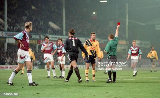 24 November 1993 London Premier League Football West Ham United v Arsenal referee Paul Durkin shows the red card to David Seaman as Nigel Winterburn...