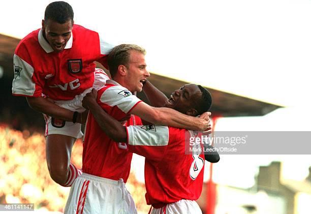 04 November 1995 Premiership Arsenal FC v Manchester United Denis Bergkamp celebrates his goal with Arsenal teammates Ian Wright and Glenn Helder