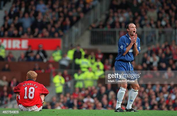 02 November 1996 FA Carling Premiership Manchester United v Chelsea Paul Scholes of Manchester United sits on the floor while Frank Leboeuf of...