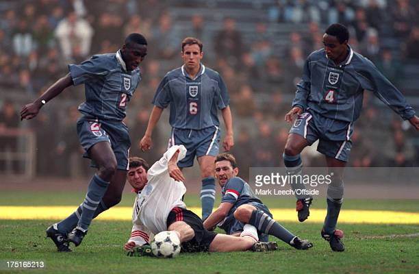 09 November 1996 International football Georgia v England England captain Tony Adams tackles Shota Arveladze with support from Sol Campbell Gareth...