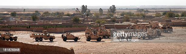 november 2, 2011 - military vehicles parked outside loy karez, kandahar province, afghanistan. - military convoy stock photos and pictures