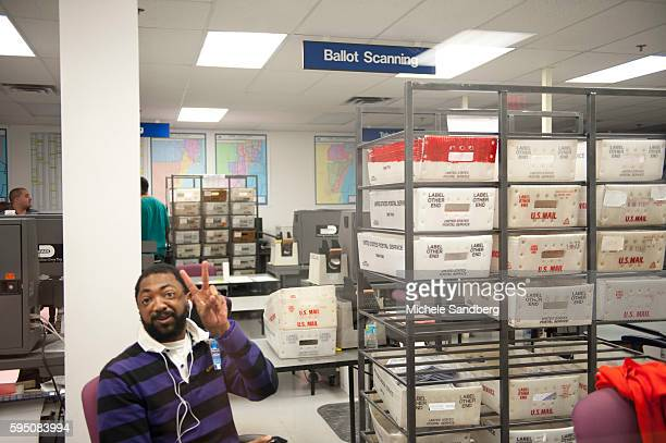 November 2 2012 VOTING WORKER PROCESSING RETURNED ABSENTEE BALLOTS IN PRECISE ORDER This room processes all Absentee Ballots that are returned from...