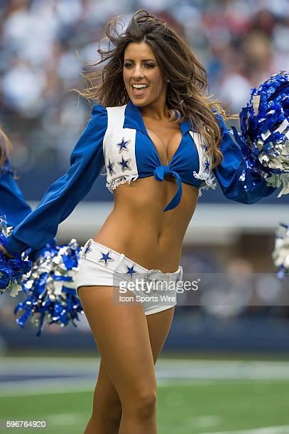 A Dallas Cowboys cheerleader performs during a football game between the Dallas Cowboys and Arizona Cardinals at ATT Stadium in Arlington TX