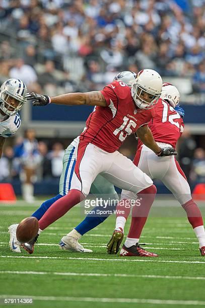 Arizona Cardinals wide receiver Michael Floyd fumbles the ball during a football game between the Dallas Cowboys and Arizona Cardinals at ATT Stadium...