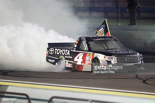 Erik Jones, driver of the Toyota Certified Used Vehicles Toyota celebrates winning the Camping World Championship at the Ford EcoBoost 200 at...
