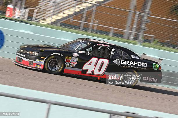 Josh Reaume driver of the Braille Battery/Grafoid Dodge during practice for the Ford EcoBoost 300 at HomesteadMiami Speedway in Homestead FL