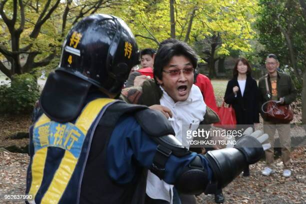 November 20 Tokyo Japan Police officers block right wing activists as they attack some 100 civic group members holding a demonstration against...