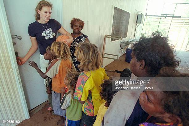 White teacher with aboriginal pupils at the community school Aboriginal assistant teachers aid with cultural differences and translate their language...