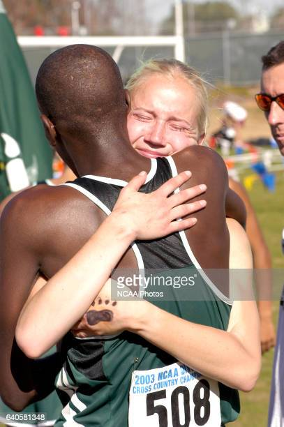 Adams State teamates Mohamed Aden and Stephanie Bylander hug each other after clinching both the Men's and Women's team titles during the NCAA Photos...