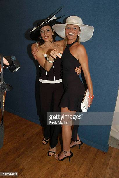4 November 2003 Australian actors GEORGIE PARKER and TAMMY MACINTOSH at the Flemington Racecourse for the Melbourne Cup Day during the Melbourne Cup...
