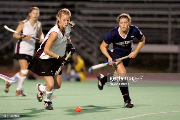 Salisbury's Brittany Elliot advances the ball upfield as Middlebury's Channing Weymouth gives chase during the Division 3 Women's Field Hockey...