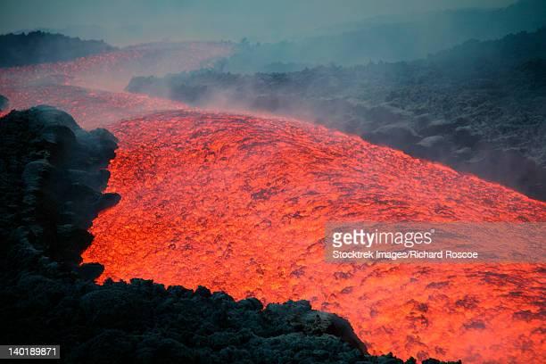 November 2006 - Lava flow at nightfall during eruption of Mount Etna volcano, Sicily, Italy.