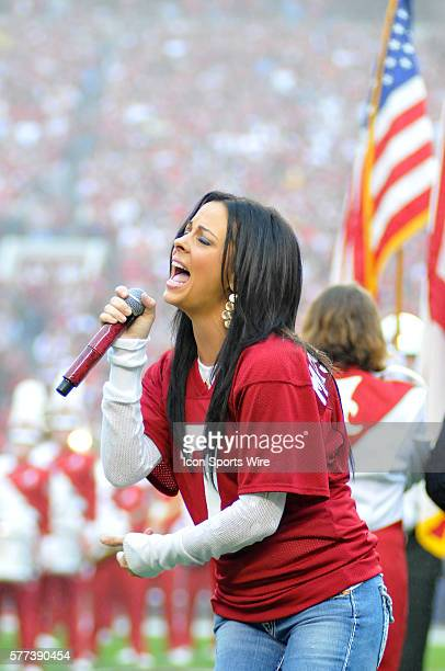 Sara Evans country music star and wife of former Alabama quarterback Jay Barker sings the national anthem at the 2008 Auburn v Alabama game in...