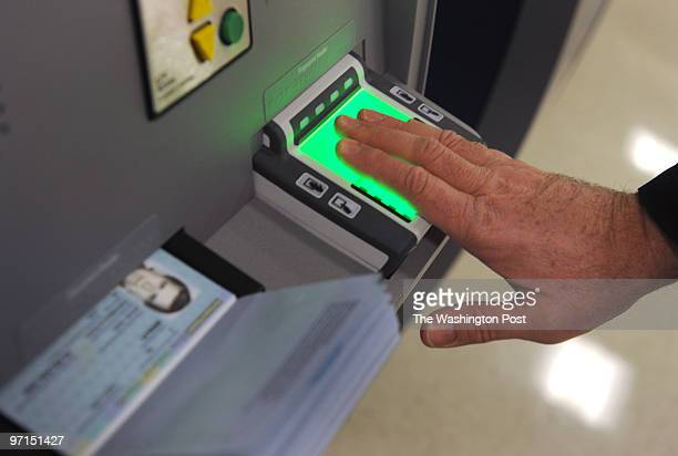 November 2009 CREDIT Katherine Frey / TWP Dulles VA Global Entry Trusted Traveler machines at Dulles International that allow for faster processing...