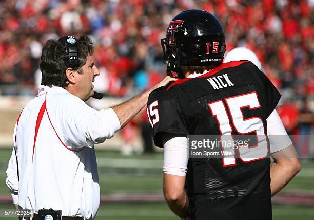 Texas Tech Head Coach Mike Leach talks to Texas Tech quarterback Taylor Potts during Texas Tech's 41-13 victory over Oklahoma at Jones AT&T Stadium...