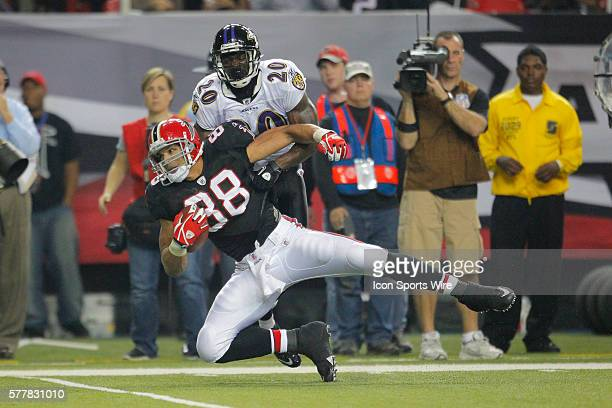 Atlanta Falcons tight end Tony Gonzalez is tackled by Baltimore Ravens safety Ed Reed in the Atlanta Falcons 2621 victory over the Baltimore Ravens...