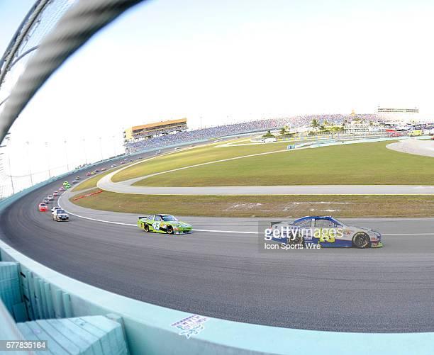 Jimmie Johnson driving the number 48 Lowe's / Kobalt Chevrolet leads AJ Allmendinger driving the number 43 Best Buy / Insignia HDTV Ford on the track...