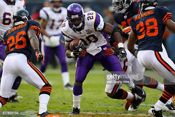 Minnesota Vikings running back Adrian Peterson runs with the ball The Chicago Bears defeated the Minnesota Vikings by a score of 27 to 13 at Soldier...
