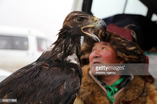 November 2013 dated photograph shows hunters with their eagles during a festival of Berkutchi in Astana hunting with eagles a type of falconry dealed...