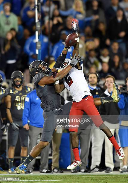 Arizona Jonathan McKnight breaks up a pass intended for UCLA Jordan Payton during an NCAA football game between the Arizona Wildcats and the UCLA...