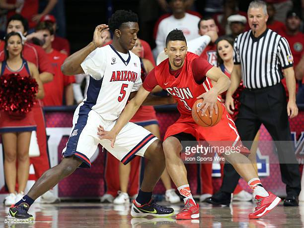 Cal State Northridge Matadors forward Stephan Hicks drives on Arizona Wildcats forward Stanley Johnson during the first half of the college...