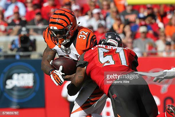 Cincinnati Bengals running back Jeremy Hill is tackled by Tampa Bay Buccaneers outside linebacker Danny Lansanah during the NFL regular season game...