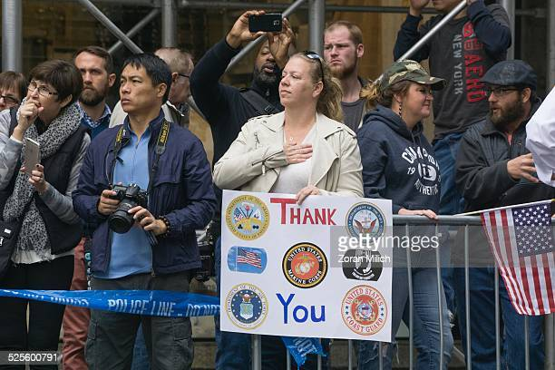 11 November 2014 Crowds watch with signs of thanks at the Veterans Day celebrations in the Manhattan Borough of New York New York USA