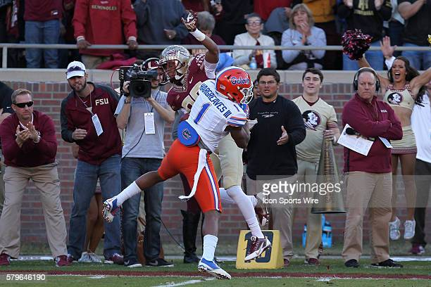 Florida State Seminoles wide receiver Rashad Greene is hit by Florida Gators defensive back Vernon Hargreaves III as he catches a pass during the...