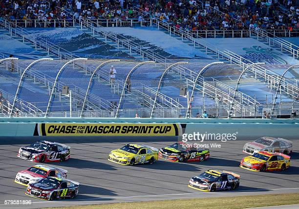 Jeff Gordon driver of the No24 Drive to End Hunger Chevy Kevin Harvick driver of the No4 Budweiser Chevy Denny Hamlin driver of the No11 FedEx...