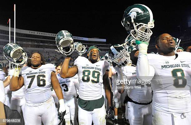 Michigan State T Donavon Clark DE Shilique Calhoun and NT Lawrence Thomas sing their alma mater and celebrate after the game The Michigan State...