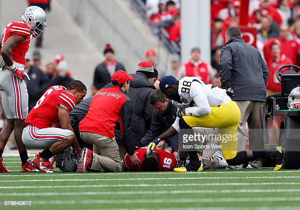 Michigan Wolverines quarterback Devin Gardner shows great sportsmanship and support for Ohio State Buckeyes quarterback JT Barrett after a game...