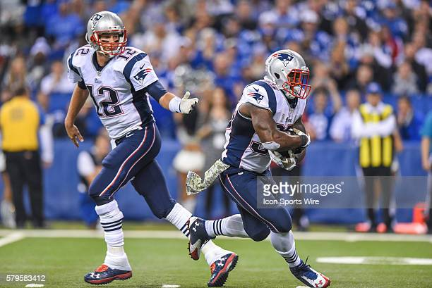 New England Patriots Quarterback Tom Brady [4012] hands the football to New England Patriots Running Back Jonas Gray [18297] in action during a...