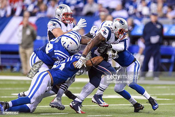 New England Patriots Running Back Jonas Gray [18297] battles with Indianapolis Colts players in action during a football game between the...