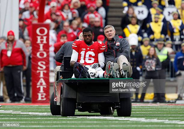 Ohio State Buckeyes quarterback JT Barrett leaves the field on a cart after a game ending injury to his right leg during the game between the Ohio...