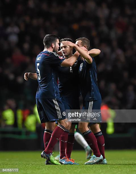 14 November 2014 Scotland players from left Grant Hanley Russell Martin and Steven Whittaker celebrate their side's victory UEFA EURO 2016...