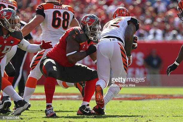 Tampa Bay Buccaneers defensive tackle Gerald McCoy tackles Cincinnati Bengals running back Jeremy Hill during the NFL regular season game between the...