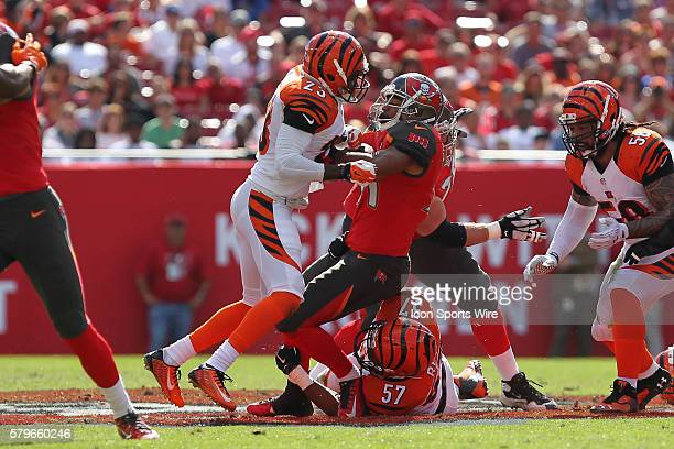 Tampa Bay Buccaneers running back Charles Sims is tackled by Cincinnati Bengals outside linebacker Vincent Rey and Cincinnati Bengals cornerback...