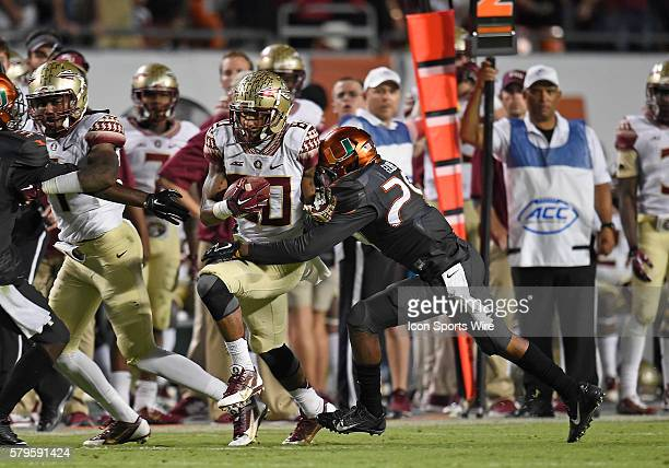 University of Miami defensive back Corn Elder tackles Florida State University wide receiver Rashad Greene in FSU's 3026 victory at Sun Life Stadium...