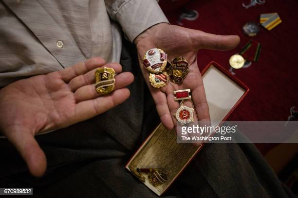 Alexey Koptev one of 16 Jehovah's Witnesses accused of extremist activity shows an medals and honor which he was awarded during service in the army...