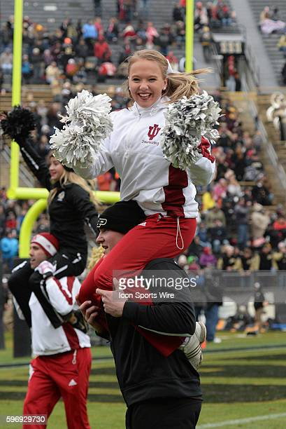 28 November 2015 | An Indiana Hoosier Cheerleader sits atop a Purdue Boilermaker's shoulders during a break in the action going into the fourth...
