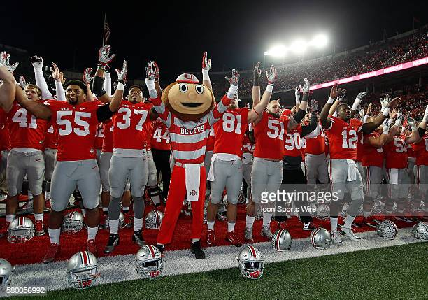 Brutus the Buckeye signs Carmen Ohio with the team following their victory between the Ohio State Buckeyes and the Minnesota Golden Gophers at the...