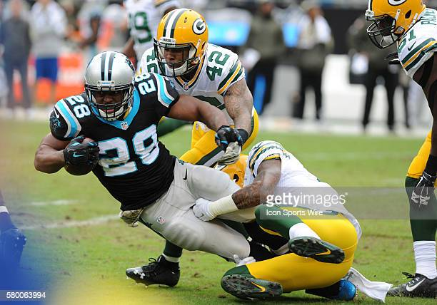 Carolina Panthers running back Jonathan Stewart gets tackled on the play during the NFL football game between the Green Bay Packers and the Carolina...
