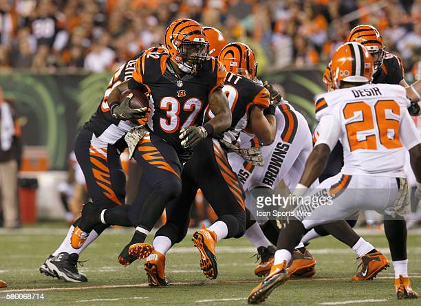 Cincinnati Bengals halfback Jeremy Hill runs against Cleveland Browns' Pierre Desir during the second half of play at Paul Brown Stadium in...