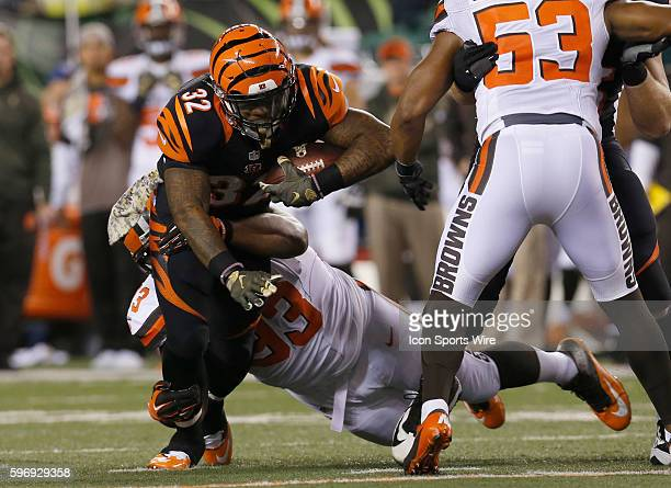 Cincinnati Bengals halfback Jeremy Hill tackled by Cleveland Browns' John Hughes during the second half of play at Paul Brown Stadium in Cincinnati...