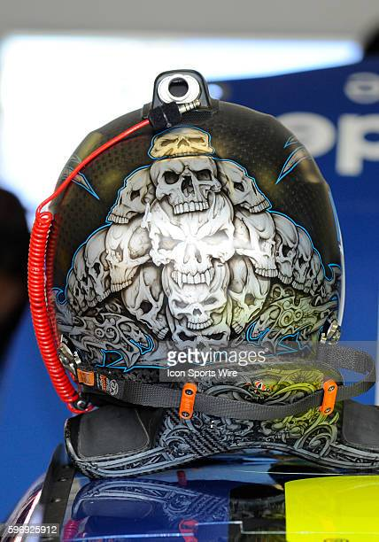 Dale Earnhardt Jr driver of the Nationwide Chevy helmet decorated with skulls sit on his car in the garage during a practice session for the Ford...